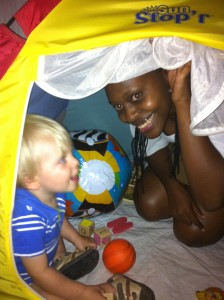 Auntie Sheila playing with Josiah in his tent